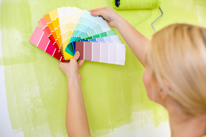 Woman with scale of paint swatches